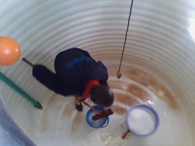 man cleaning out a cistern water tank